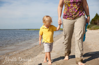 Mom and Son walking on the beach hand in hand